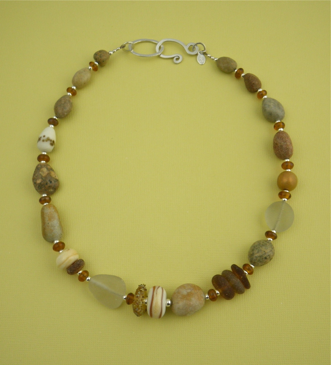 Beach rock necklaces barbara s fernald jewelry this combination of sea glass and beach rocks also includes some of sue kennedys beads i really love the way her etched beads compliment the rough sea solutioingenieria Gallery