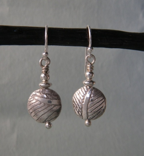 Fine silver saucer bead earrings.